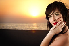 Young beautiful girl posing on beach Stock Images