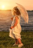Young beautiful girl posing for the camera at sunset Royalty Free Stock Photos