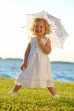 Young beautiful girl posing for the camera in whit Stock Image