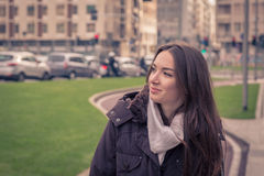Young beautiful girl posing in the city streets Stock Photos