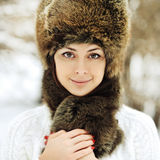 Young beautiful girl posing in a fur hat - close up Stock Photos
