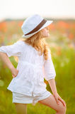 Young beautiful girl posing in a hat outdoor. The young beautiful girl posing in a hat outdoor stock images