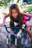 Young beautiful girl posing on the old rusty motorbike Royalty Free Stock Images