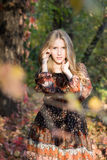 Young beautiful girl posing in park, autumn portrait Stock Image