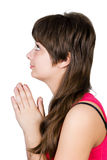 Young beautiful girl praying. isolated Stock Photos