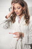Young beautiful girl with a pregnancy test Stock Photo