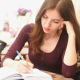 Young beautiful girl is preparing for exam Royalty Free Stock Photo