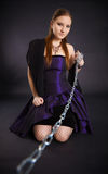 Young beautiful girl pulls out a chain leash Stock Photo