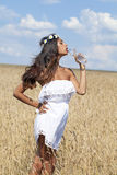 Young beautiful girl quenches thirst Stock Photography