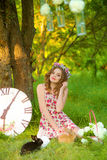 Young beautiful girl with a rabbits Royalty Free Stock Image