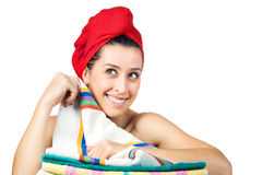 Young beautiful girl with rad towel on her head. The young beautiful girl with rad towel on her head Royalty Free Stock Photography