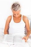 Young beautiful girl reading a book royalty free stock photo