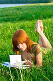 Young beautiful girl reading a book Stock Photos