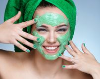 Young beautiful girl receiving cosmetic facial mask. stock image