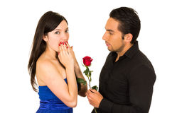 Young beautiful girl receiving red rose Stock Images