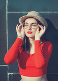 Young beautiful girl in red blouse and glasses Royalty Free Stock Images