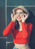 Young beautiful girl in red blouse and glasses Royalty Free Stock Photography