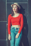 Young beautiful girl in red blouse and glasses Royalty Free Stock Photo