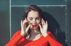 Young beautiful girl in red blouse and glasses Royalty Free Stock Image