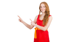 Young beautiful girl in red dress pointing Stock Images
