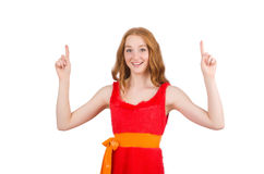 Young beautiful girl in red dress pointing Stock Photo