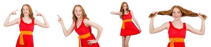 The young beautiful girl in red dress pointing isolated on white royalty free stock images
