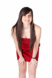 Young beautiful girl with red dress standing Stock Image