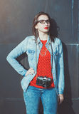 Young beautiful girl in red jersey with glasses Royalty Free Stock Photo