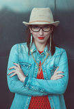 Young beautiful girl in red jersey with glasses Stock Photo