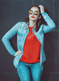 Young beautiful girl in red jersey with glasses Royalty Free Stock Image