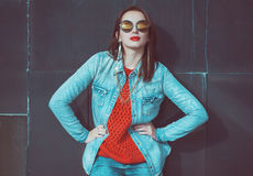 Young beautiful girl in red jersey with glasses Stock Photography