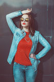 Young beautiful girl in red jersey with glasses Royalty Free Stock Images