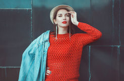 Young beautiful girl in red jersey with hat Stock Image