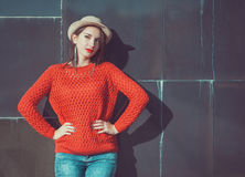 Young beautiful girl in red jersey and hat Stock Images