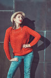 Young beautiful girl in red jersey and hat Royalty Free Stock Image