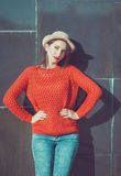 Young beautiful girl in red jersey and hat Stock Photography