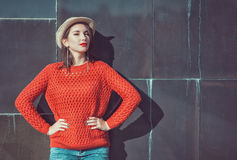 Young beautiful girl in red jersey and hat Stock Photos