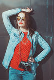Young beautiful girl in red jersey with sunglasses Royalty Free Stock Photo