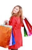 Beautiful woman with a shopping bags. Isolated on white. Royalty Free Stock Photography