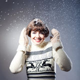 Young beautiful girl rejoices to snow Royalty Free Stock Image
