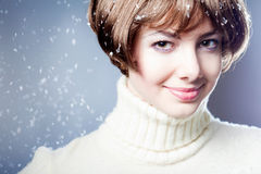 Young beautiful girl rejoices to snow Royalty Free Stock Photos