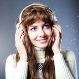 Young beautiful girl rejoices to snow Royalty Free Stock Photography