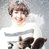 Young beautiful girl rejoices to snow Royalty Free Stock Photo