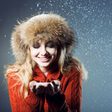 Young beautiful girl rejoices to snow Royalty Free Stock Images