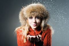 Young beautiful girl rejoices to snow Stock Photography