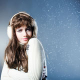 Young beautiful girl rejoices to snow Stock Photos