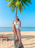 Young beautiful girl relaxes on the beach Stock Photography