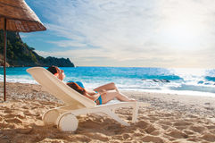 Young beautiful girl relaxing on beach Stock Photography