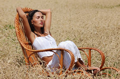 Young beautiful girl relaxing in a chair Royalty Free Stock Photos