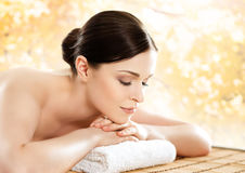 Young and beautiful girl relaxing in s spa salon Stock Images